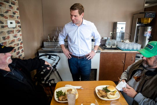 U.S. Rep. Eric Swalwell, D-CA, introduces himself to Jack Hough and David Bleuer, both of West Bend, while they dine at Chrome Restaurant and Catering on Monday, April 1, 2019, in Algona. Swalwell was born in Iowa and has made several trips to the state while eyeing a run for president.