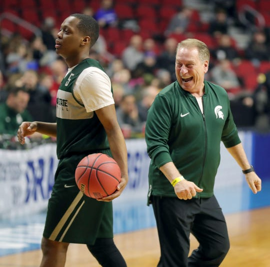 Michigan State coach Tom Izzo smiles as guard Cassius Winston walks by, as the team prepares for their first round  NCAA tournament game against Bradley, March 20, 2019 at Wells Fargo Arena in Des Moines, Iowa.