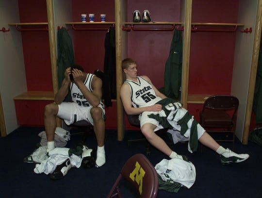 Michigan State's Aloysius Anagonye and Adam Ballinger slump in the locker room after  their 80-61 lost to Arizona at the Final Four at the Metrodome in Minneapolis on March 31, 2001.