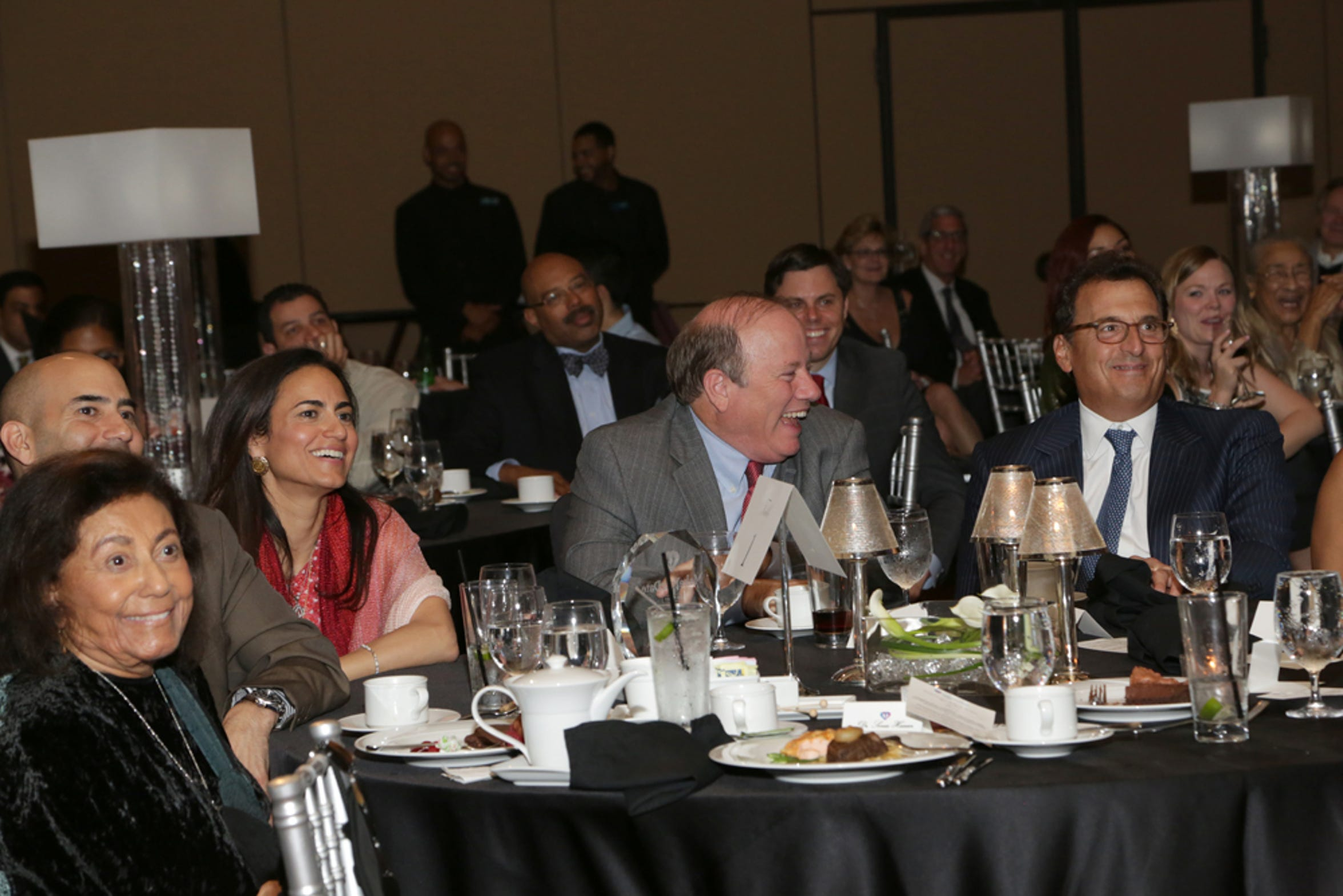 Dr. Sonia Hassan, in red, sits with Detroit Mayor Mike Duggan during the 2015 fundraising gala for Hassan's Make Your Date program at MGM Grand Detroit.