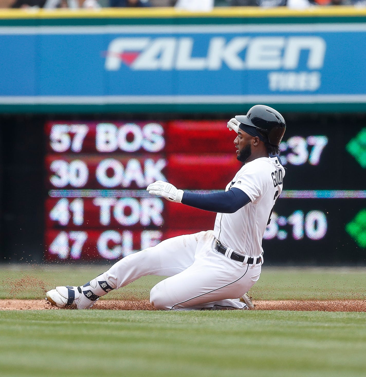 Tigers short stop Niko Goodrum slides towards the second base after hitting a single during the third inning at Comerica Park on Thursday, April 4, 2019.