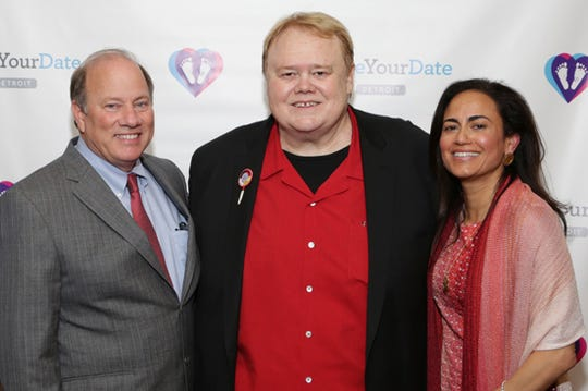 Detroit Mayor Mike Duggan poses with headlining comedian Louie Anderson and Dr. Sonia Hassan, the president and director of Make Your Date, at the 2015 fundraiser gala at the MGM Grand Detroit.