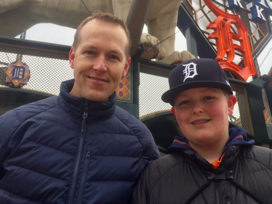 John Carson, 48, and his son Ryan, 15, of Howell, wait for Comerica Park to open for Opening Day.