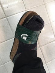 "Julie Janke Peacock of suburban Chicago broke her good-luck MSU slippers during the Big 10 Tournament.  So she fixed them with Spartan Duct tape to keep her ritual alive: ""I wear the same outfit every game."""