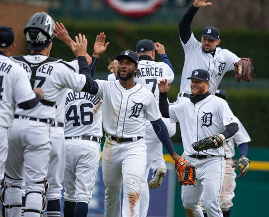 The Tigers celebrate after the Tigers' 5-4 win over the Royals on Thursday, April 4, 2019.