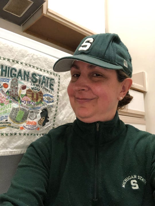 MSU alum Kate Good, who grew up in Grosse Pointe and now lives in suburban Chicago, eats a lime yogurt before every Spartan basketball game for luck. And, she wears the same outfit for every game: green underwear, vintage MSU T-shirt and MSU fleece.