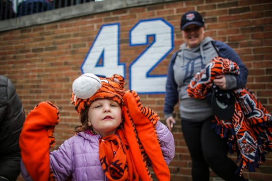 Lily Wojnowski, 5, finds her seat with her aunt Cate Kawalec, 33, before the start of the Detroit Tigers' Opening Day game against Kansas City Royals at Comerica Park in Detroit on Thursday, April 4, 2019.