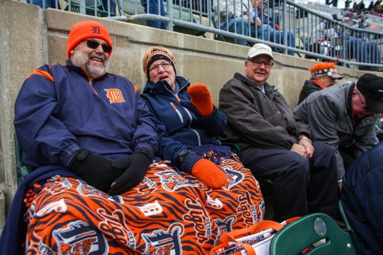 Perry (63) and Debbie (64) Keith, of White Lake, Mich. stay warm with a Tigers' blanket, gloves and jackets, during Detroit Tigers' Opening Day at Comerica Park in Detroit on Thursday, April 4, 2019.