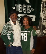 Craig and Jeanine Clemons of Southfield get all decked out in MSU swag for Spartan basketball games, which they watch at the Detroit Beer Co. They bring a shiny brass Spartan helmet for luck, and have ONLY MSU fans rub it.