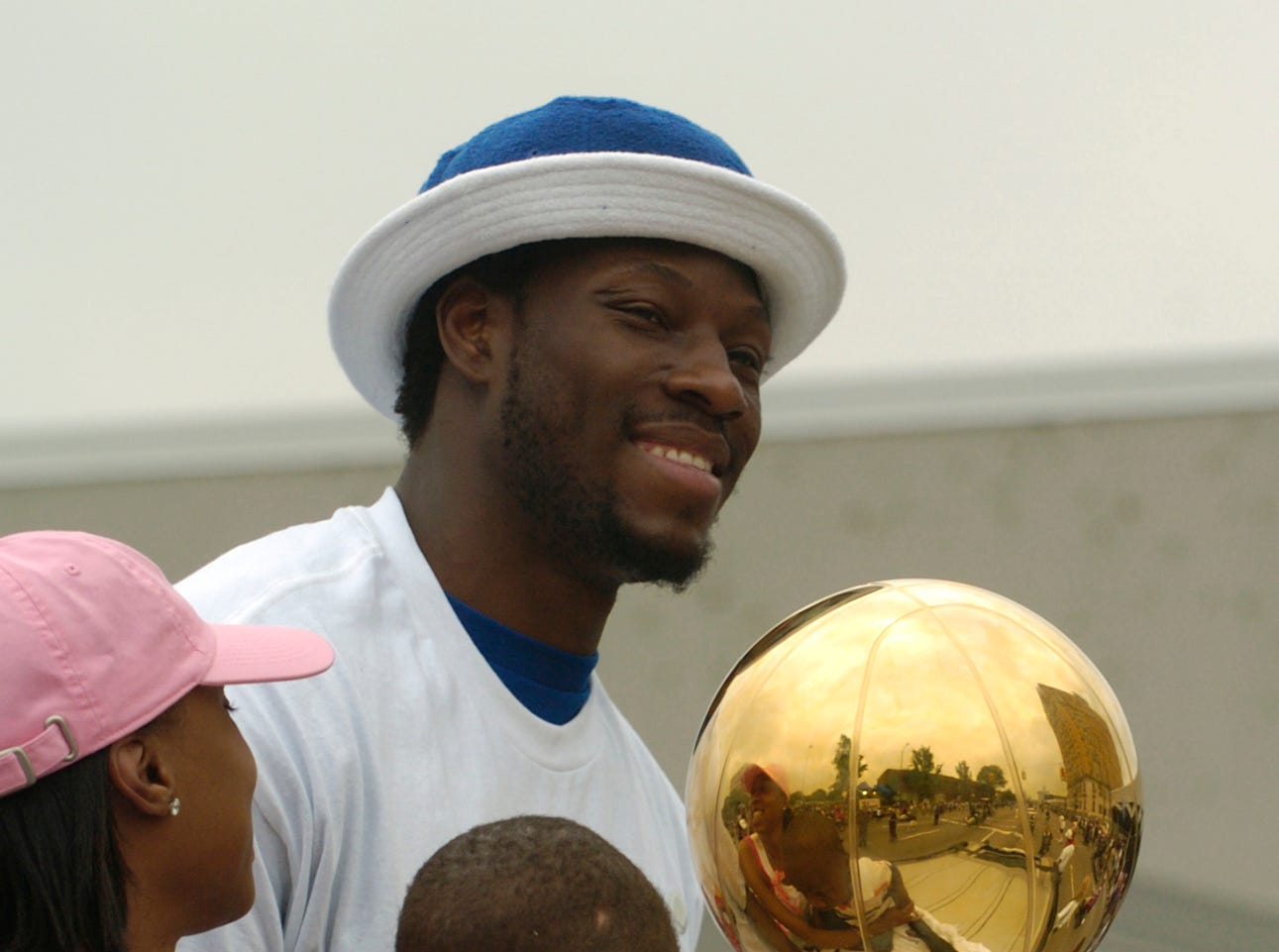 Ben Wallace with his family and the championship trophy in the parade.
