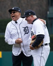 Former Tigers pitching great Willie Hernandez shares a laugh with Tigers manager Ron Gardenhire after throwing the ceremonial first pitch before Thursday's game.