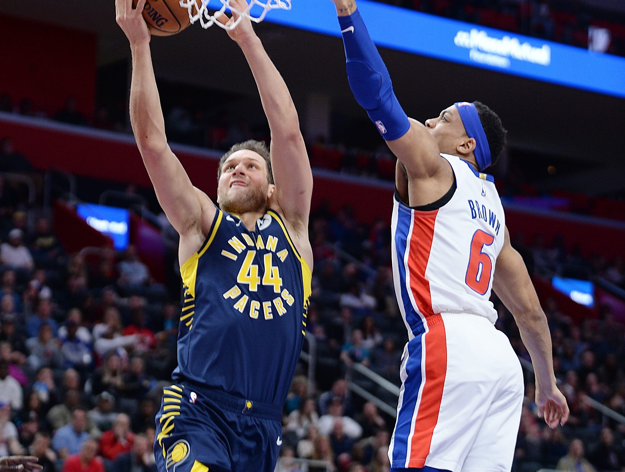 Pacers' Bojan Bogdanovic scores over Pistons' Bruce Brown in the third quarter.