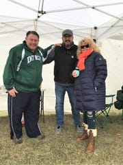 Mike Bowdell, left, in his tent along Woodward with friend Mike Dawson of Allen Park and Bowdell's sister, Liz Bowdell-Sheldon of Howell.