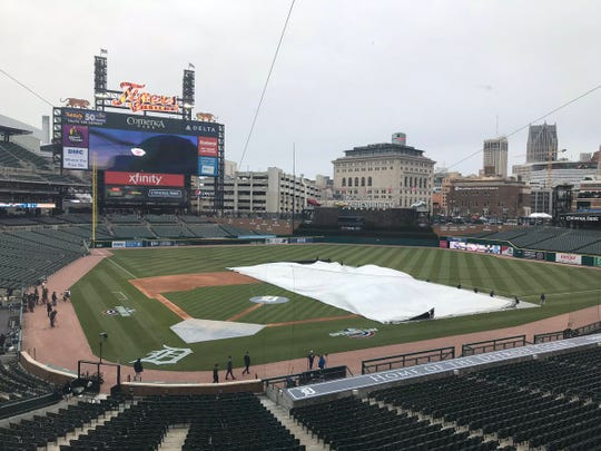 The Comerica Park groundscrew pulls the tarp Thursday morning