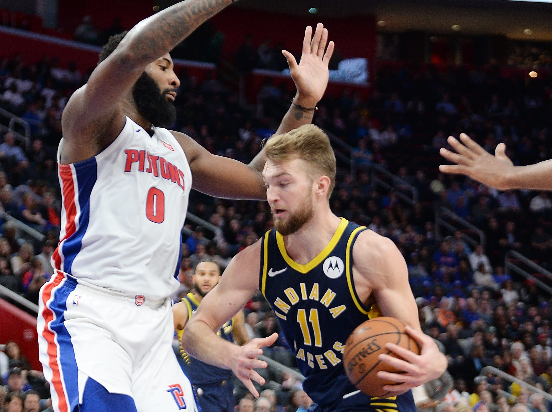 Pacers' Domantas Sabonis looks for room around Pistons' Andre Drummond in the fourth quarter.