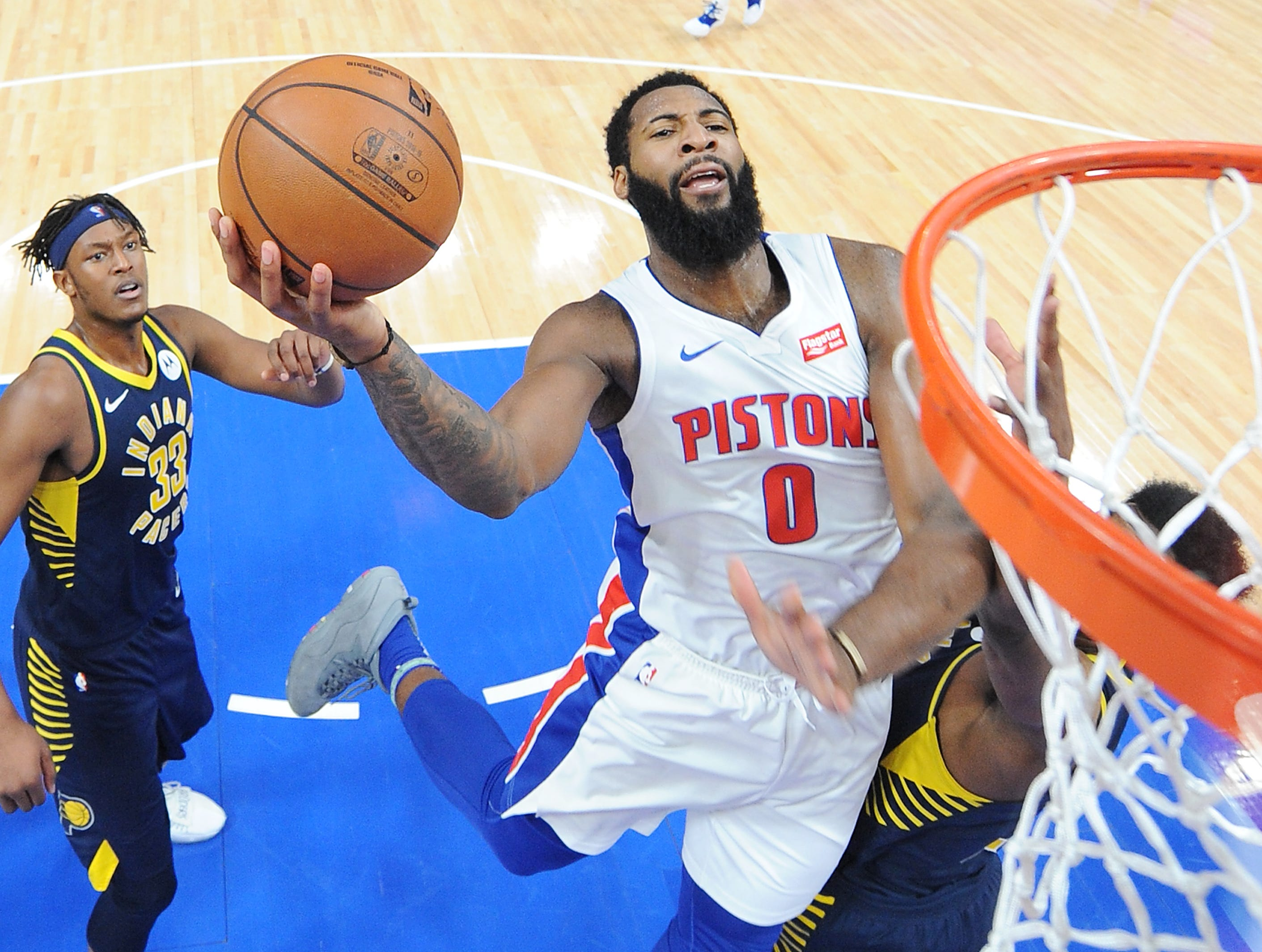 Pistons' Andre Drummond shoots over Pacers' Thaddeus Young in the third quarter. Drummond had a game high 28 points and 19 rebounds.