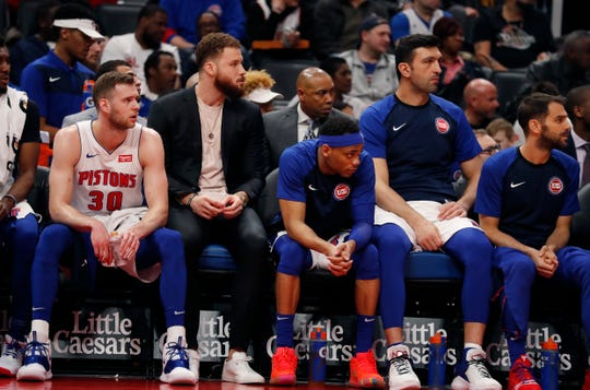 Detroit Pistons forward Blake Griffin, second from left, sits on the bench during the second half Wednesday night.