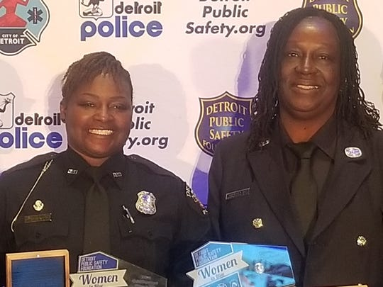 Detroit Officer Sandra Whitfield and Verdine Day, fire engine operator, are honored Thursday as the Detroit police and fire departments' women of the year.