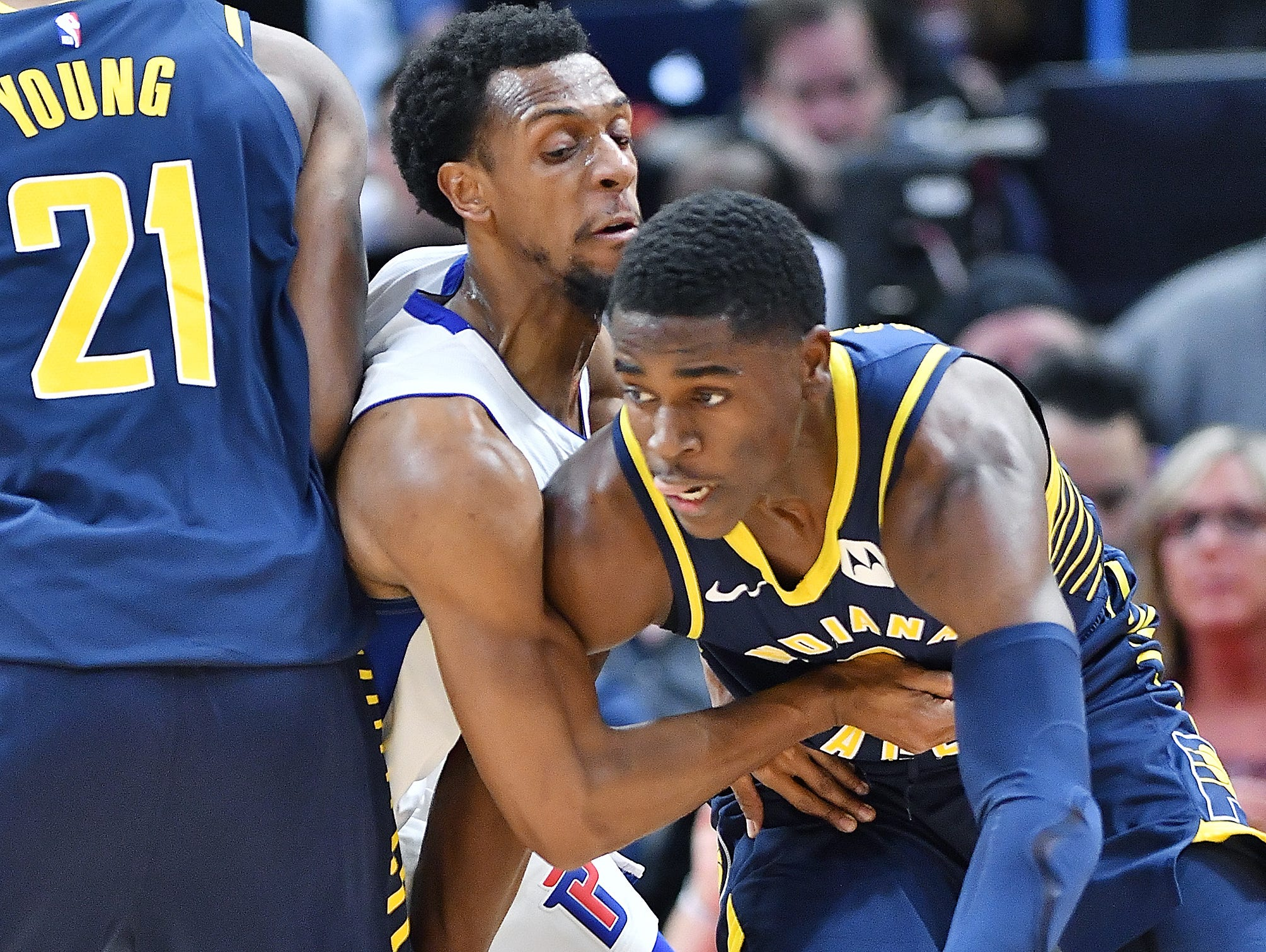 Pistons' Ish Smith fights through a screen to defend Pacers'  Aaron Holiday in the second quarter.