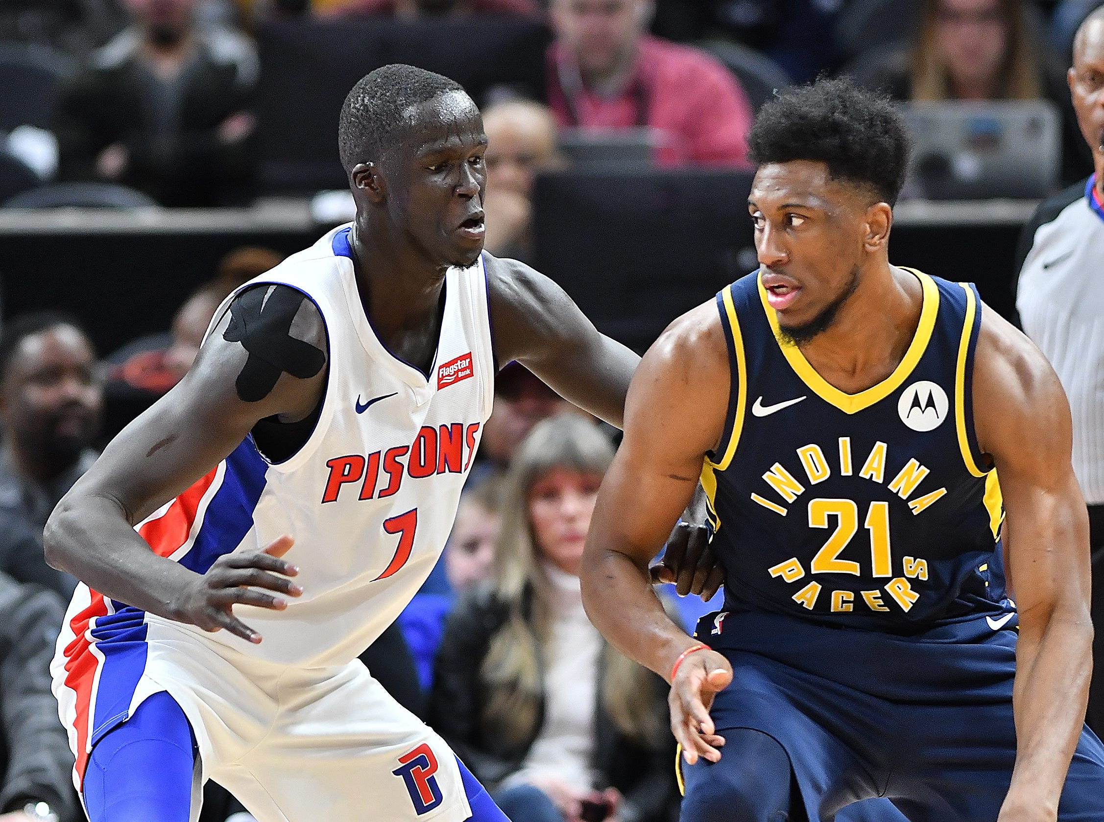 Pacers' Thaddeus Young looks for room around Pistons' Thon Maker in the second quarter.