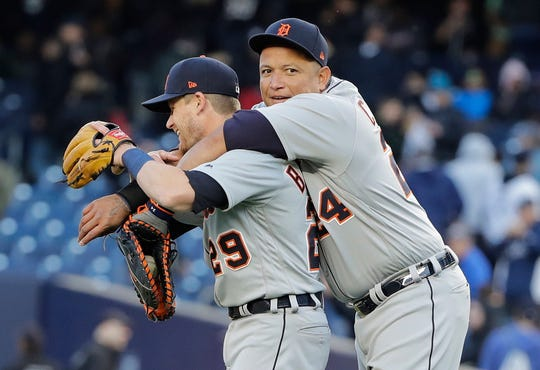The Detroit Tigers' Miguel Cabrera gives  Gordon Beckham a hug after the win over the New York Yankees.