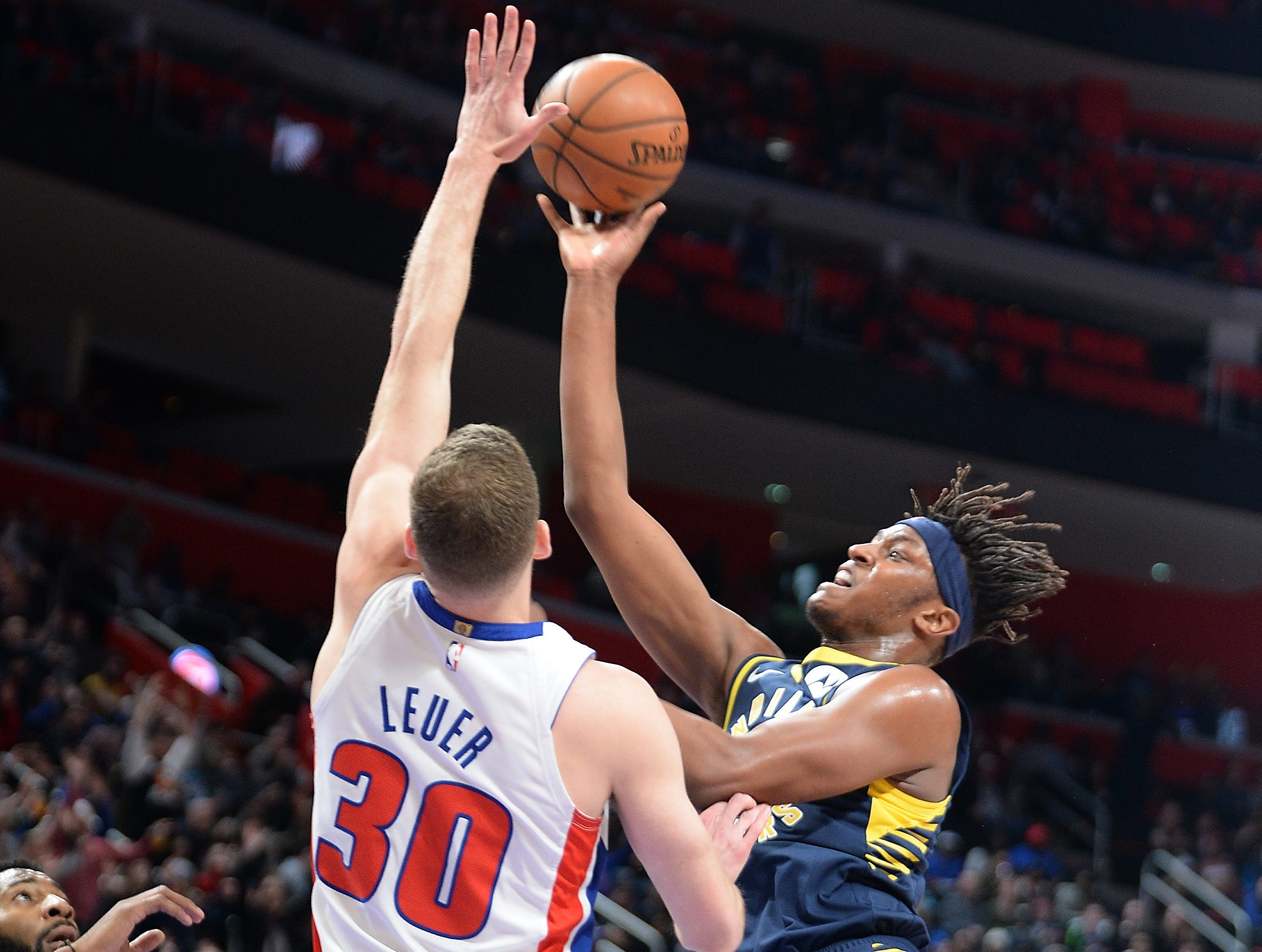 Pacers' Myles Turner scores over Pistons' Jon Leuer in the fourth quarter.