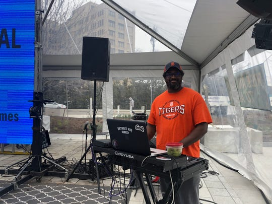 DJ L BooG spins danceable pop hits inside the tent party at Beacon Park ahead of the Tigers home opener.