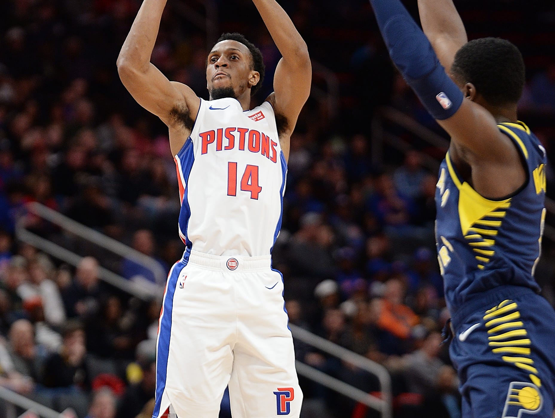Pistons' Ish Smith shoots over Pacers' Aaron Holiday in the second quarter.