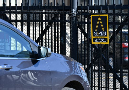A Maven car sits in the parking lot of Alden Towers in Detroit.  Detroit and GM's car sharing service Maven late last month launched a pilot program that lets Maven park cars in six on-street parking spaces in downtown, Midtown, Corktown and Southwest Detroit.