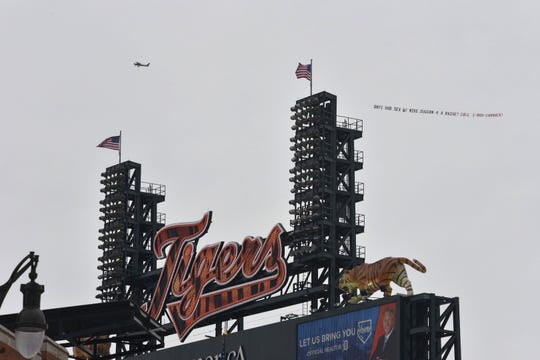 A banner created by Robert Carmack, businessman and antagonist of Detroit Mayor Mike Duggan, circles Comerica Park Thursday morning.