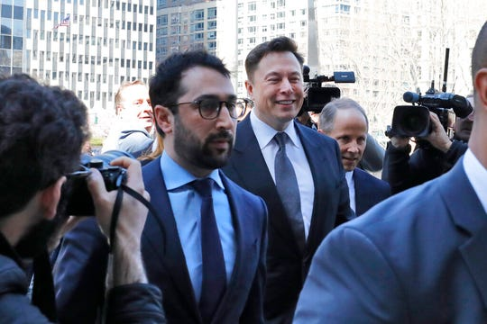 Tesla CEO Elon Musk, center, arrives at Manhattan Federal Court, in New York, Thursday, April 4, 2019.
