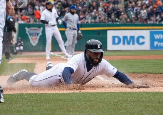 Tigers baserunner Josh Harrison slides home for a run in the first inning Thursday at Comerica Park.