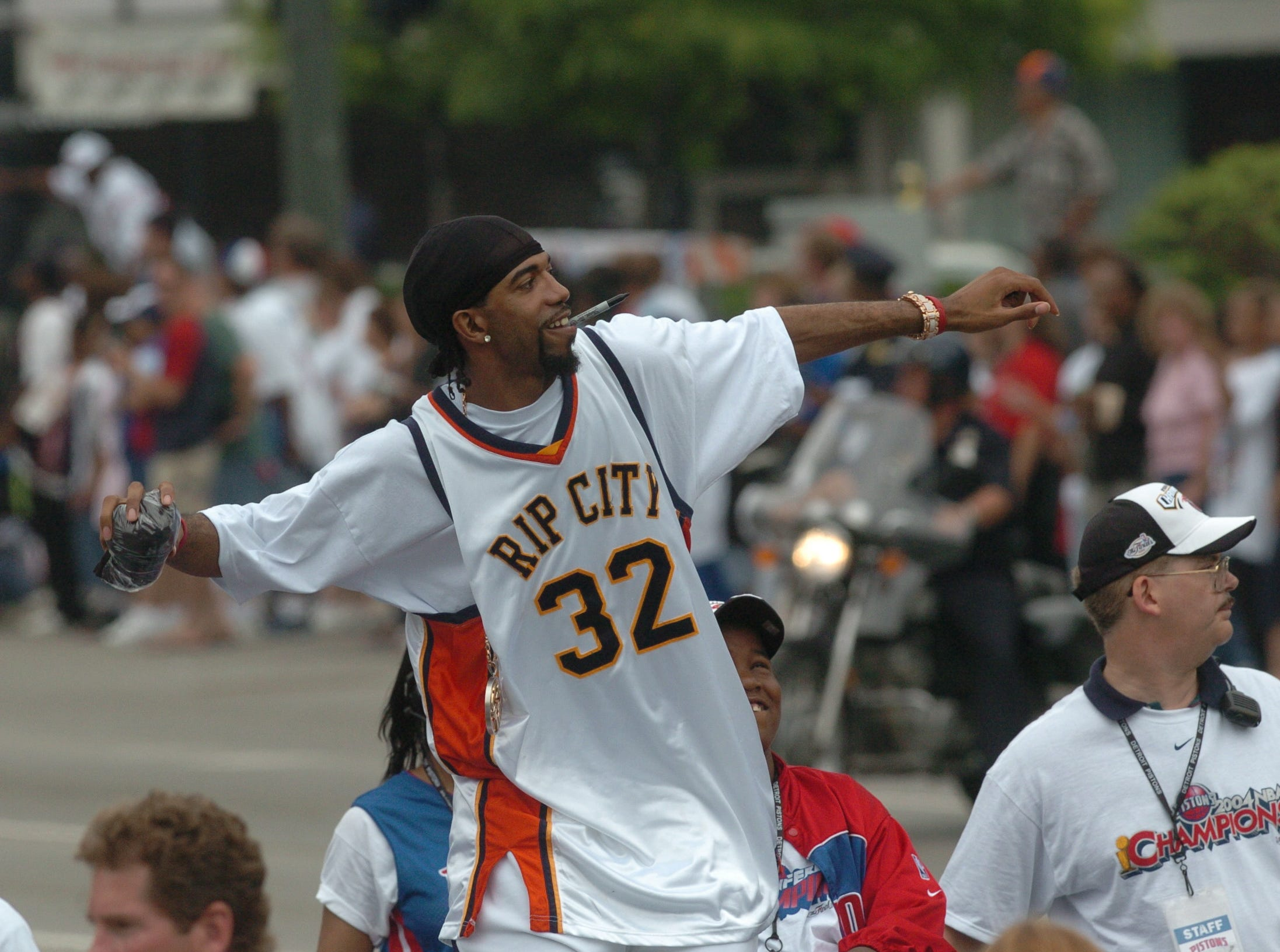 Detroit's Richard Hamilton tosses one of many personally-signed T-shirts into the crowd during the Detroit Pistons victory parade.