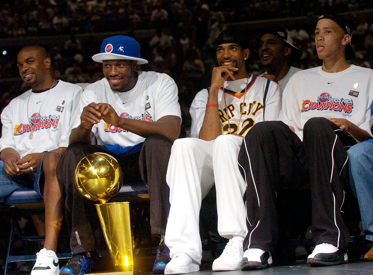 Left to right, Mike James, Ben Wallace, Richard Hamilton and Tayshaun Prince listen during the rally.