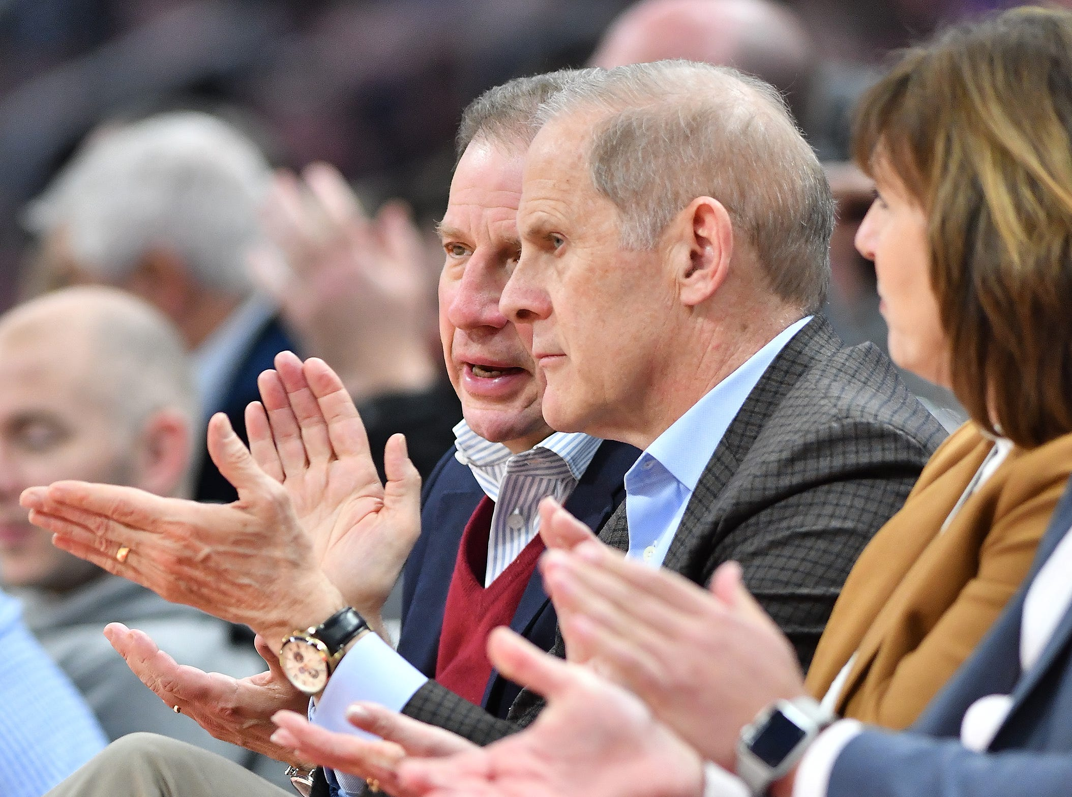 Michigan head coach John Beilein and Arn Tellem,(l), Pistons Vice Chairman watched the game in the fourth quarter.