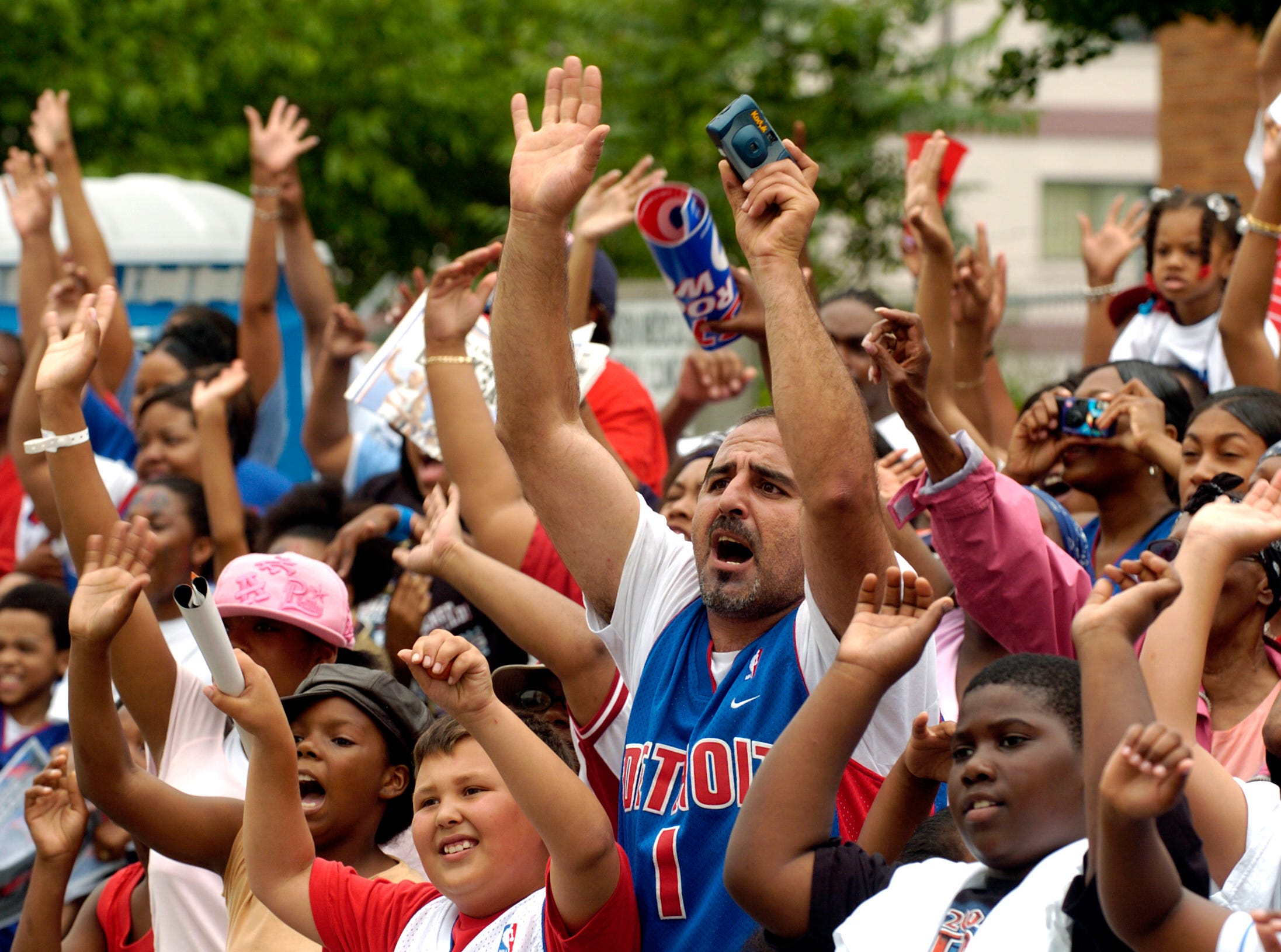 Thousands of fans line Jefferson Avenue to cheer the 2004 NBA champion Detroit Pistons.
