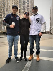Dan Vought of Shelby Township, right, and his two children, Jacob, 17, and Alexis, 18 warm up with coffee ahead of the Detroit Tigers home opener on April 4, 2019.