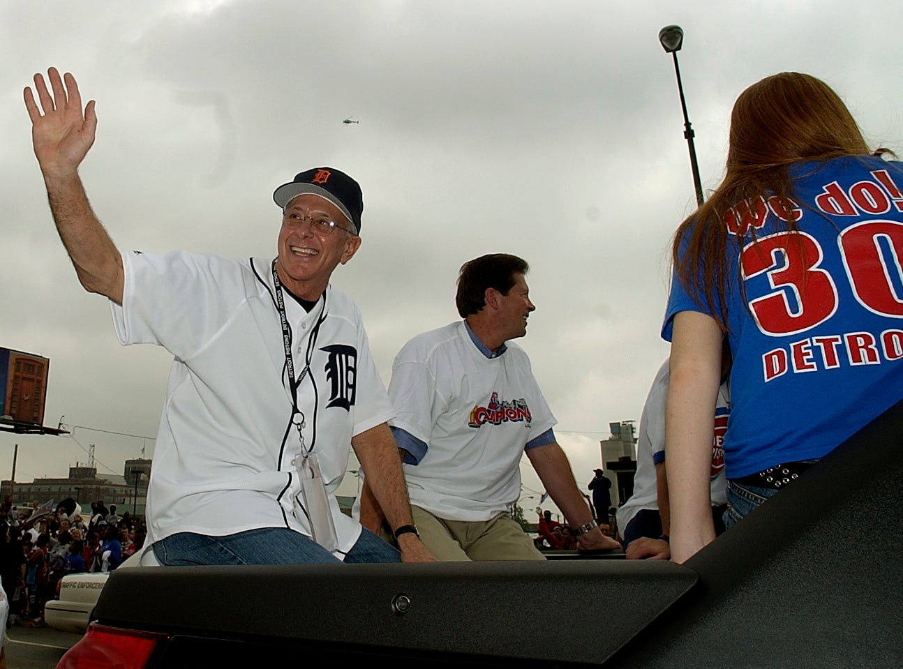 Pistons head coach Larry Brown, left, waves to the crowd with Tom Wilson, head of Palace Entertainment, during the parade. Thursday, June 17, 2004.