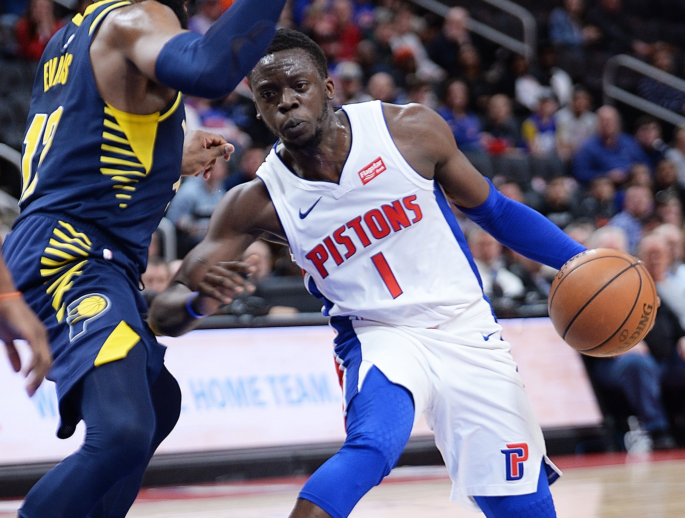 Pistons' Reggie Jackson drives around Pacers' Tyreke Evans in the first quarter.