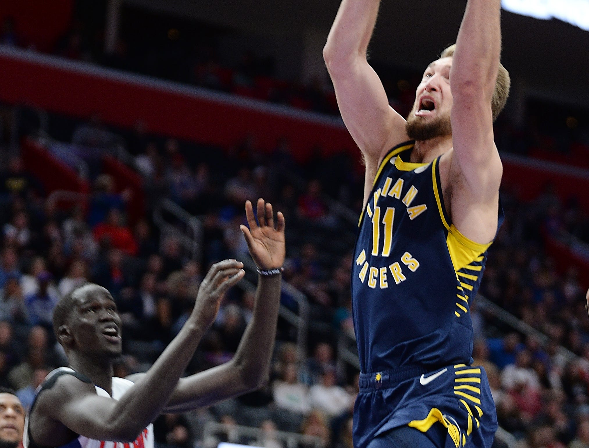 Pacers' Domantas Sabonis scores over Pistons' Thon Maker in the fourth quarter.