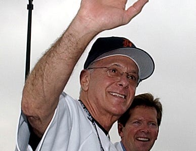 Pistons head coach Larry Brown waves to the crowd.