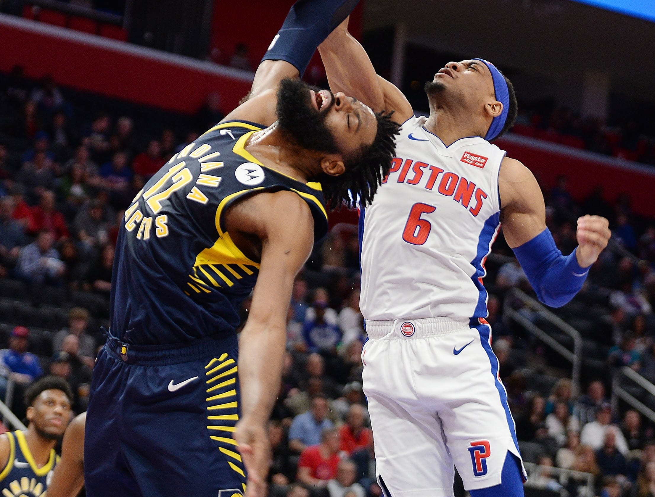 Pistons' Bruce Brown fouls Pacers' Tyreke Evans in the fourth quarter.
