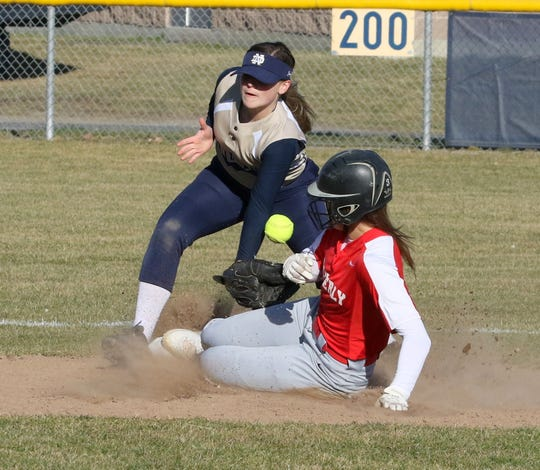 Waverly's Wendi Hammond safely slides into second as Elmira Notre Dame's Ava Mustico covers the base on April 3, 2019 in Southport.