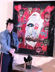 Elmira native Michael Houghton shows off one of his artistic creations, highlighting his fascination with crows and ravens, that will be on display at Community Arts of Elmira.