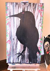 Much of Elmira native Michael Houghton's artwork is based on a lifelong fascination with crows and ravens.