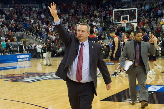 University of Southern Indiana Head Coach Rodney Watson holds four fingers up to the crowd as he exits the court after the Screaming Eagles defeated the West Texas A&M Buffaloes during the NCAA Men's Division II Quarterfinals at Ford Center in Evansville, Ind., Wednesday, March 27, 2019. Watson tied Bruce Pearl for most all-time coaching victories at USI with 231 after Saturday's win over Malone.
