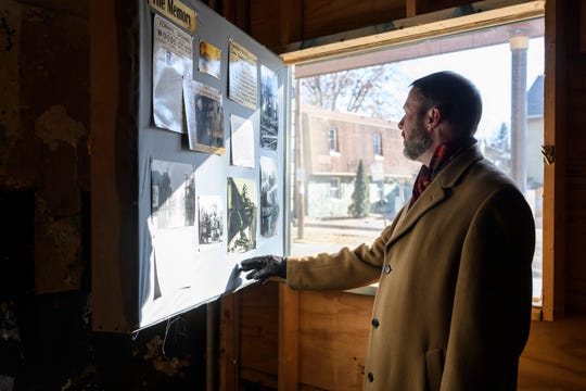 Ken Haynie III points out a display of old pictures and historical information about the old Alhambra Theatre located in Haynie's Corner in Evansville. Haynie and his business partner Aaron Kendall purchased the theatre in December with the hopes of restoring the space.