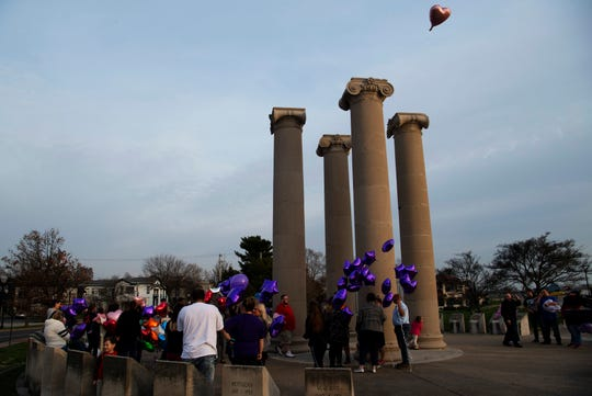 A heart-shaped balloon is released ahead of the more than 150 others before a memorial service for Chloe Randolph-Abdikadir at the Four Freedoms Monument on the riverfront in Downtown Evansville Wednesday evening. A majority of the balloons were purple to call attention to domestic violence. The 20-year-old Henderson, Ky., resident was found murdered March 23, 2019, and her husband, Mohamud Abdikadir is being held without bail in the Henderson County Detention Center for the murder.