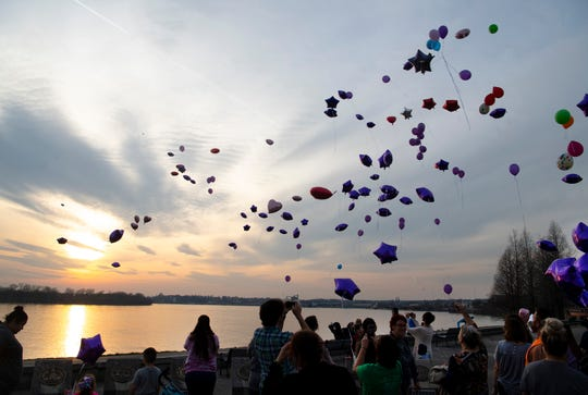 More than 150 balloons are launched in memory of Chloe Randolph-Abdikadir at the Four Freedoms Monument on the riverfront in Downtown Evansville Wednesday evening. A majority of the balloons were purple to call attention to domestic violence. The 20-year-old Henderson, Ky., resident was found murdered March 23, 2019, and her husband, Mohamud Abdikadir is being held without bail in the Henderson County Detention Center for the murder.
