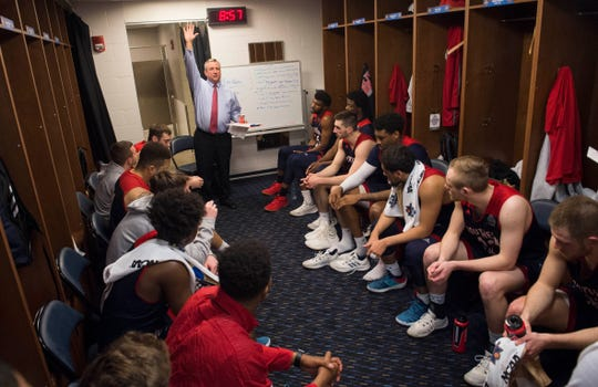 University of Southern Indiana Head Coach Rodney Watson meets with his team at halftime in the locker room during the NCAA Men's Division II Quarterfinals at Ford Center in Evansville, Ind., Wednesday, March 27, 2019. USI defeated West Texas A&M, 94-84.